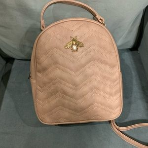 Tan butterfly vegan leather backpack excellent!!